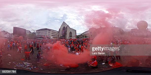 Liverpool fans light flares as they enjoy the atmosphere and sunshine at Barfuesserplatz in the city centre prior to the UEFA Europa League Final...
