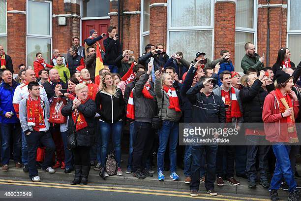 Liverpool fans line the streets as they await the arrival of the team bus prior to the Barclays Premier League match between Liverpool and Manchester...