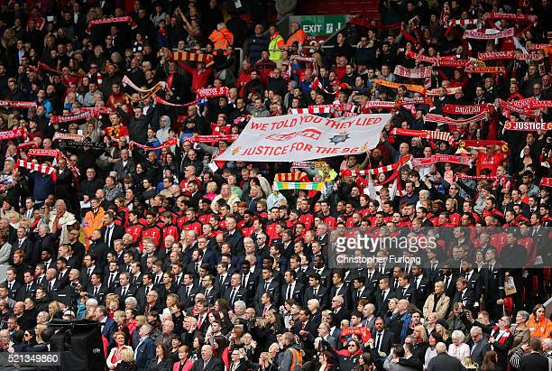 Liverpool fans players and dignitaries sing 'You'll Never Walk Alone' during a memorial service to mark the 27th anniversary of the Hillsborough...