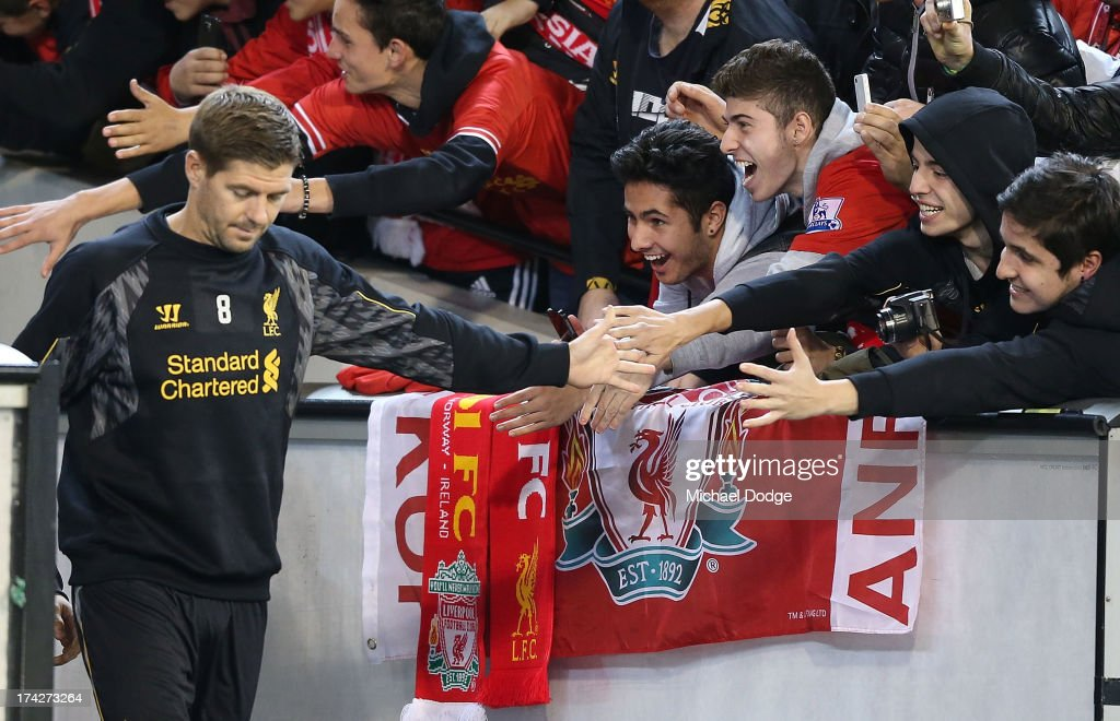 Liverpool fans reach out to <a gi-track='captionPersonalityLinkClicked' href=/galleries/search?phrase=Steven+Gerrard&family=editorial&specificpeople=202052 ng-click='$event.stopPropagation()'>Steven Gerrard</a> who enters the field during a Liverpool FC training session at Melbourne Cricket Ground on July 23, 2013 in Melbourne, Australia.