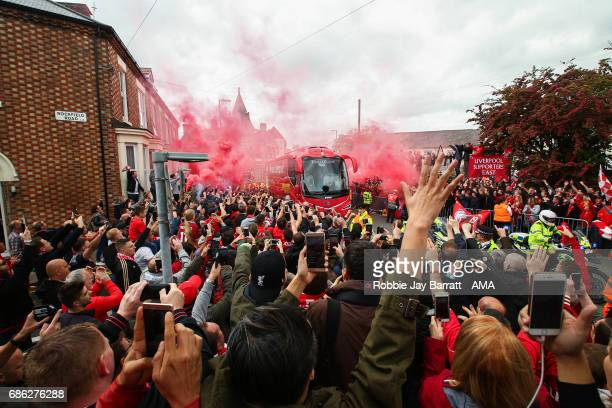 Liverpool fans set off flares as the team bus arrives during the Premier League match between Liverpool and Middlesbrough at Anfield on May 21 2017...
