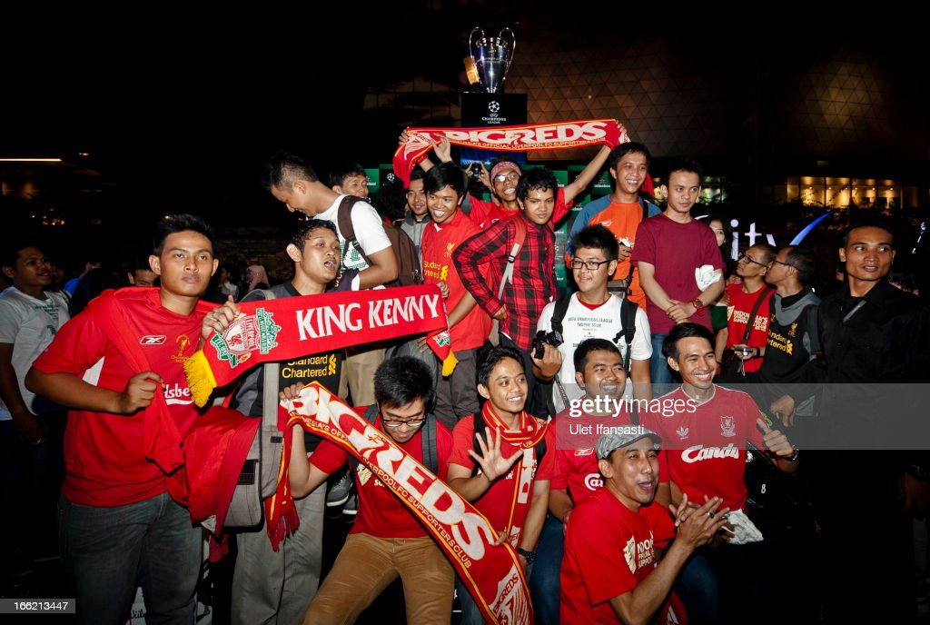 Liverpool fans show their enthusiasm during the trophy unveiling as part of the UEFA Champions League Trophy Tour 2013 presented by Heineken at Gandaria City Shopping Mall on April 10, 2013 in Jakarta, Indonesia.