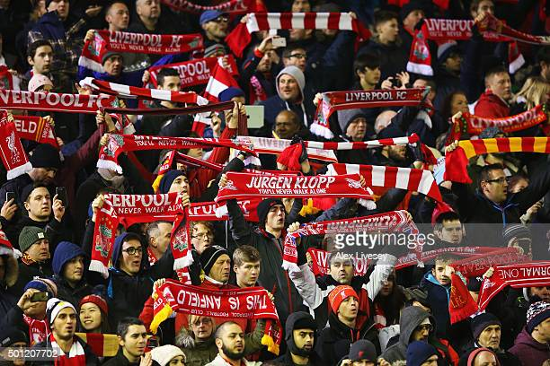 Liverpool fans show their support prior to the Barclays Premier League match between Liverpool and West Bromwich Albion at Anfield on December 13...
