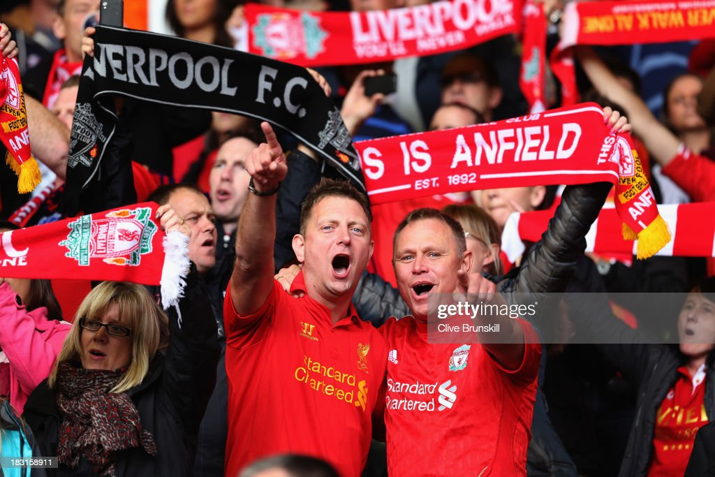 Liverpool fans sing during the Barclays Premier League match between Liverpool and Crystal Palace at Anfield on October 5, 2013 in Liverpool, England.
