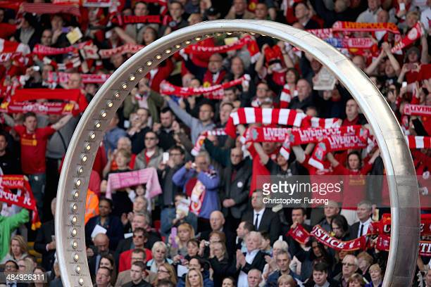 Liverpool fans sing 'You'll Never Walk Alone' behind a sculpture baring the names of the 96 victims during the Hillsborough memorial service marking...