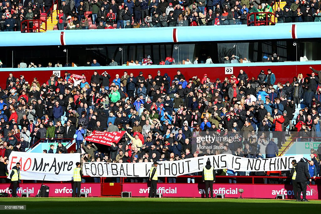 Liverpool fans unfurl a banner with a message directed at the club's chief executive, Ian Ayre, in protest against ticket prices before the Barclays Premier League match between Aston Villa and Liverpool at Villa Park on February 14, 2016 in Birmingham, England.