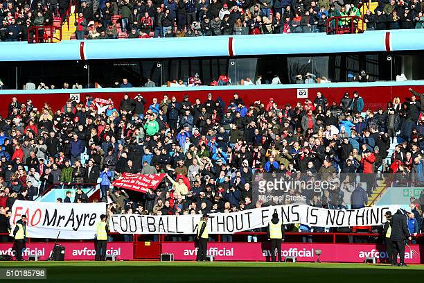 Liverpool fans unfurl a banner with a message directed at the club's chief executive Ian Ayre in protest against ticket prices before the Barclays...