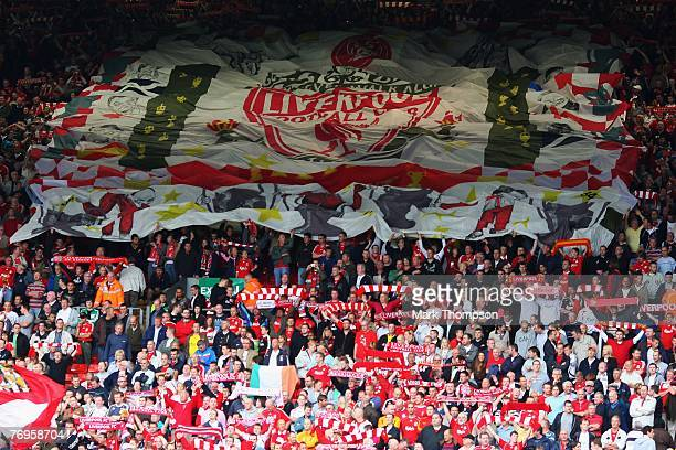 Liverpool fans unfurl a flag at the Kop end of the stadium prior to the Barclays Premier League match between Liverpool and Birmingham City at...