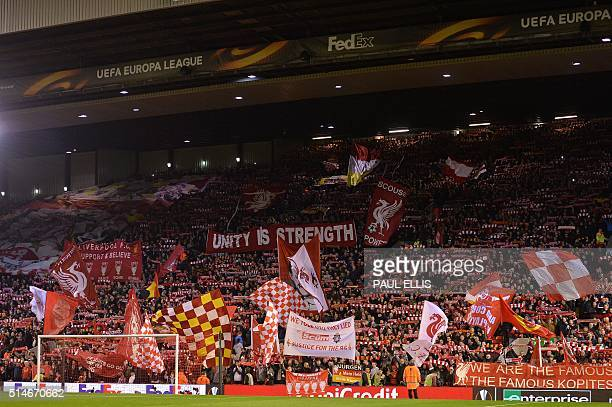 Liverpool fans wave flags and banners ahead of the UEFA Europa League round of 16 first leg football match between Liverpool and Manchester United at...