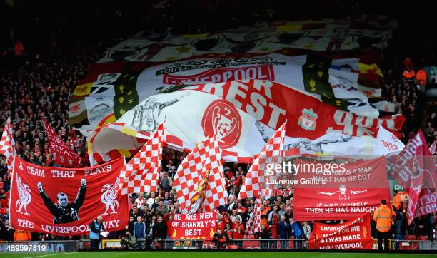 Liverpool fans wave flags and banners during the Barclays Premier League match between Liverpool and Newcastle United at Anfield on May 11 2014 in...