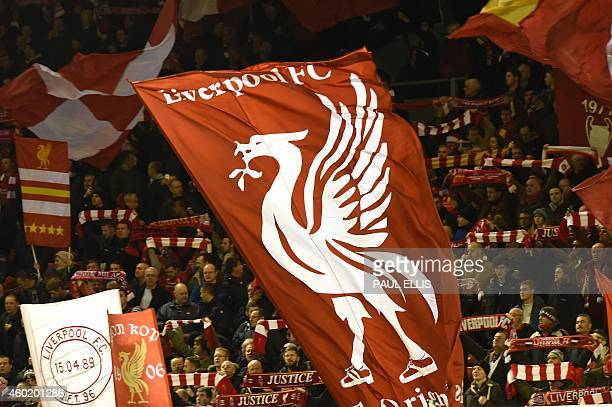 Liverpool fans wave flags during the UEFA Champions League group B football match between Liverpool and Basel at Anfield in Liverpool north west...