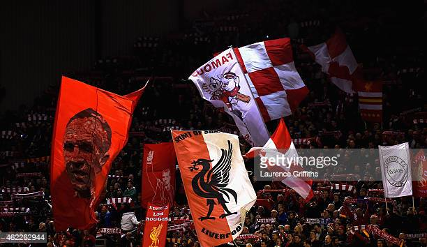 Liverpool fans wave their flags during the UEFA Champions League Group B match between Liverpool and FC Basel on December 9 2014 in Liverpool United...