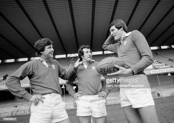 Sport October 1976 Welsh Rugby Union stars Barry John and Gareth Edwardscentrewith Liverpool and Wales football star John Toshack at Cardiff Arms Park