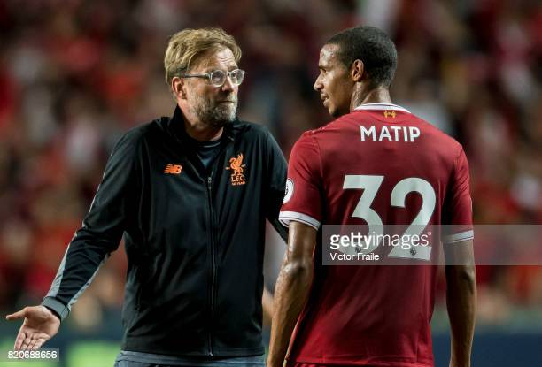 Liverpool FC Coach Jurgen Klopp talks to Liverpool FC defender Joel Matip during the Premier League Asia Trophy match between Liverpool FC and...