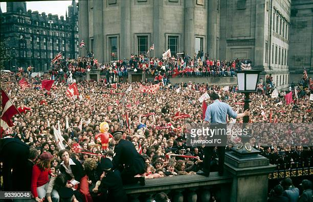 Liverpool FC fans wait for the victorious players to emerge outside the Picton Library with St George's Hall and Lime Street in background during the...