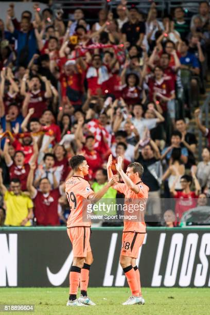 Liverpool FC forward Dominic Solanke celebrates with teammate Jon Flanagan during the Premier League Asia Trophy match between Liverpool FC and...