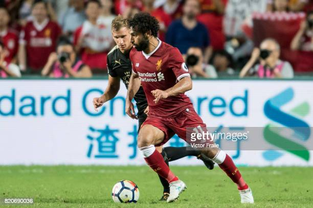 Liverpool FC forward Mohamed Salah fights for the ball with Leicester City FC midfielder Marc Albrighton during the Premier League Asia Trophy match...