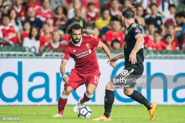 Liverpool FC forward Mohamed Salah fights for the ball with Leicester City FC defender Christian Fuchs during the Premier League Asia Trophy match...