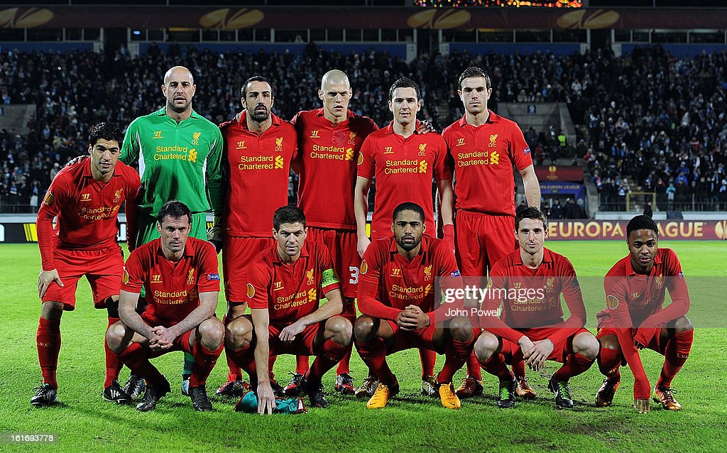 Liverpool FC line up for a group photograph before the UEFA Europa League round of 32 first leg match between FC Zenit St Petersburg and Liverpool on February 14, 2013 in Saint Petersburg, Russia.