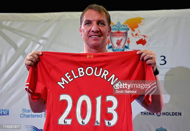 Liverpool FC Manager Brendan Rodgers holds a Liverpool jersey aloft during a Liverpool FC Press Conference at the Grand Hyatt on July 22 2013 in...