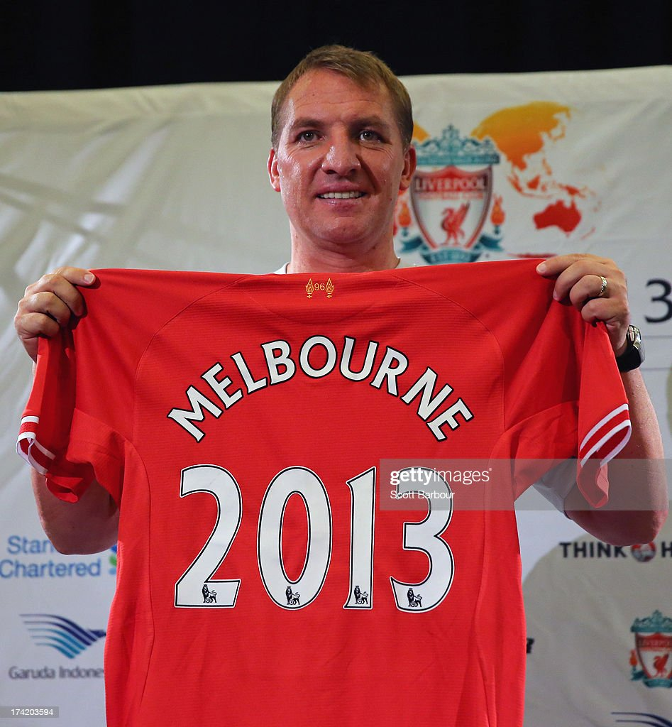 Liverpool FC Manager <a gi-track='captionPersonalityLinkClicked' href=/galleries/search?phrase=Brendan+Rodgers+-+Soccer+Manager&family=editorial&specificpeople=5446684 ng-click='$event.stopPropagation()'>Brendan Rodgers</a> holds a Liverpool jersey aloft during a Liverpool FC Press Conference at the Grand Hyatt on July 22, 2013 in Melbourne, Australia.