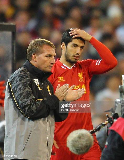Liverpool FC Manager Brendan Rodgers looks on as Luis Suarez of Liverpool is substituted into the match during the match between the Melbourne...