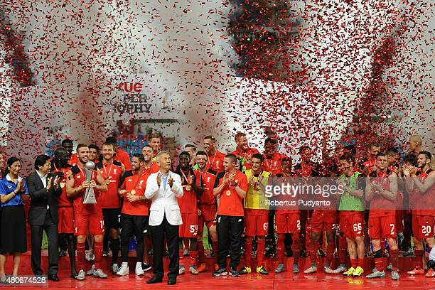 Liverpool FC team celebrate with the true Super Trophy replica after the international friendly match between Thai Premier League All Stars and...