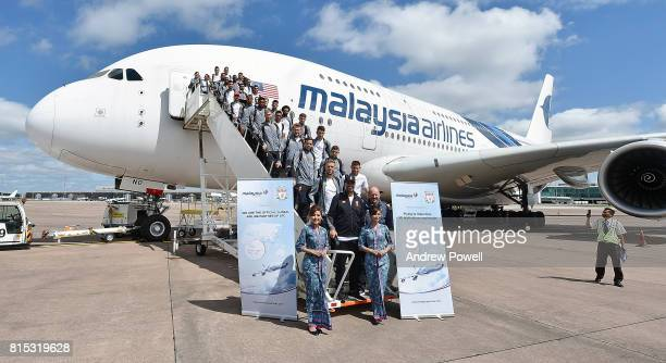 Liverpool FC team with Jurgen Klopp manager of Liverpool and Peter Moore CEO of Liverpool pose for a photograph before taking off for pre season tour...
