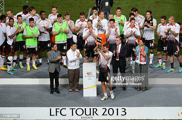 Liverpool FC with winner trophy during the international friendly match between Thailand and Liverpool at Rajamangala Stadium on July 28 2013 in...