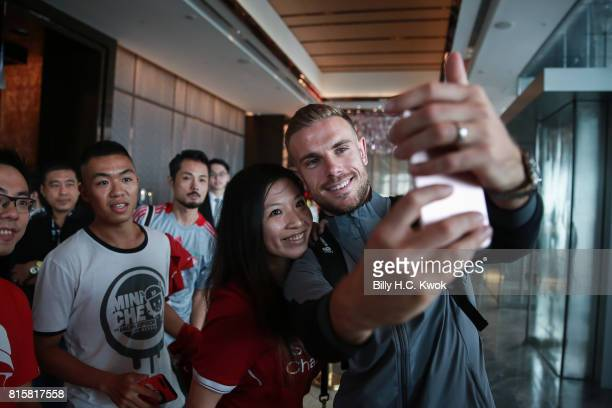 Liverpool FC's Jordan Henderson stops for a selfie with fans in Hong Kong on July 17 2017 in Hong Kong Crystal Palace Leicester City and West...