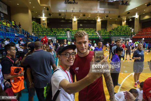 Liverpool FC's Loris Karius takes selfie with a Hong Kong fans during the Premier League Asia Trophy Skills Session at Macpherson Stadium on July 18...