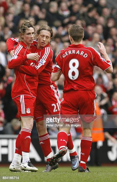Liverpool Fernando Torres celebrates with his team mates after scoring the equalizer