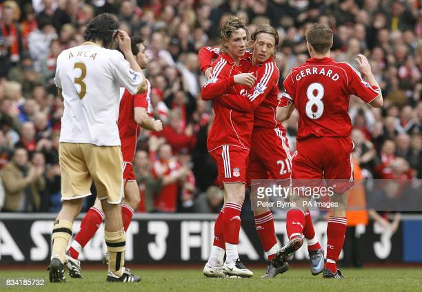 Liverpool Fernando Torres celebrates with his team mates after scoring the equalizer as Middlesbrough's Julio Arca is dejected