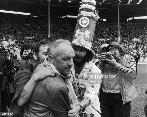 Liverpool Football Club manager Bill Shankly receives the praise of jubilant fans after FA Cup winning Liverpool's 65 defeat of League champions and...