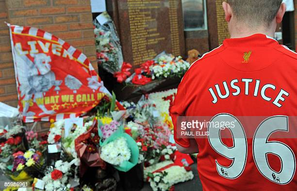 A Liverpool football club supporter looks at floral tributes and memorabilia ahead of a memorial service to mark the twentieth anniversary of the...