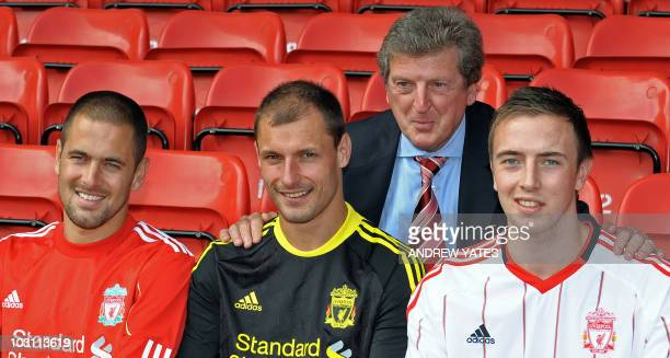 Liverpool football club's manager Roy Hodgson poses for photographers with new signings Joe Cole of England Milan Jovanovic of Serbia and Danny...