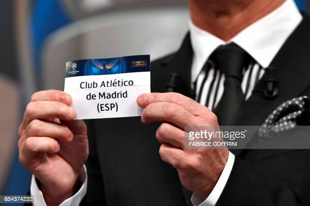 Liverpool football legend and UEFA Champions League Final Ambassador Ian Rush shows a piece of paper bearing the name of Club Atletico de Madrid...