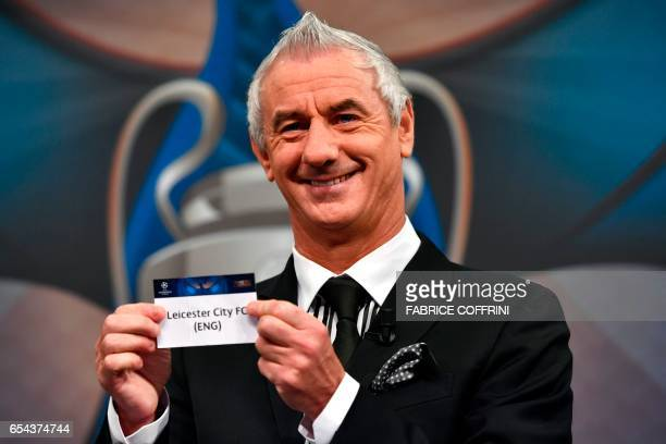 Liverpool football legend and UEFA Champions League Final Ambassador Ian Rush shows a piece of paper bearing the name of Leicester City FC during the...