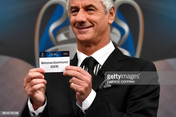 Liverpool football legend and UEFA Champions League Final Ambassador Ian Rush shows a piece of paper bearing the name of Borussia Dortmund during the...