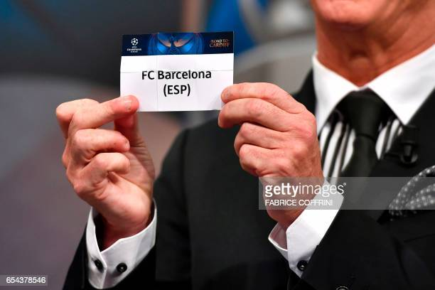 Liverpool football legend and UEFA Champions League Final Ambassador Ian Rush shows a piece of paper bearing the name of FC Barcelona during the...