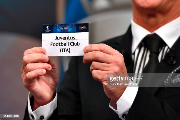 Liverpool football legend and UEFA Champions League Final Ambassador Ian Rush shows a piece of paper bearing the name of Juventus Football Club...