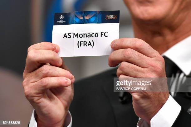 Liverpool football legend and UEFA Champions League Final Ambassador Ian Rush shows a piece of paper bearing the name of AS Monaco FC during the...