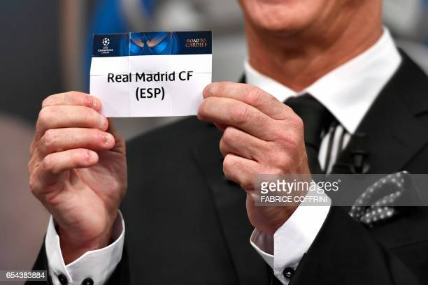 Liverpool football legend and UEFA Champions League Final Ambassador Ian Rush shows a piece of paper bearing the name of Real Madrid CF during the...
