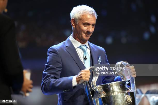 Liverpool football legend Ian Rush holds the Champions League trophy at the start of the UEFA Champions League Group stage draw ceremony on August 25...