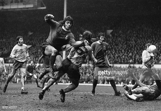 Liverpool football player Kevin Keegan leaps past Norwich City player Trevor Howard during a match at Anfield Liverpool February 2nd 1974