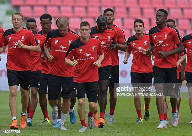 Liverpool football players warmup during a team training session at Rajamangala stadium in Bangkok on July 13 2015 Liverpool football team will play...