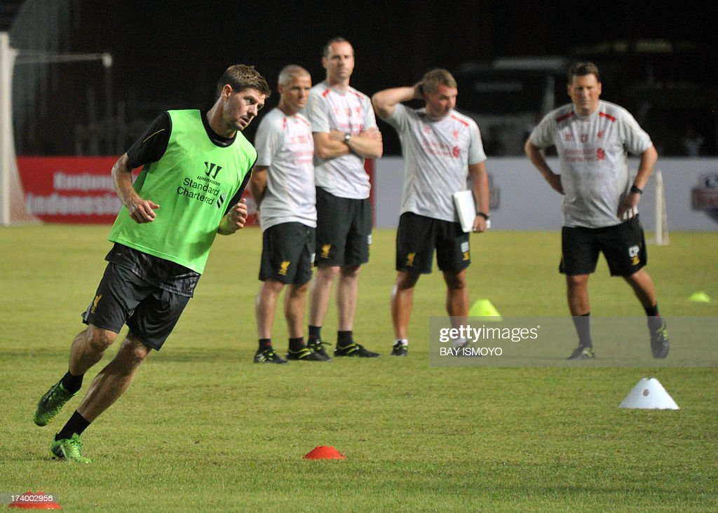 Liverpool football team captain Steven Gerrard (L) and his team attend a practice session at Bung Karno stadium in Jakarta on July 19, 2013 before their friendly match against Indonesian national team on July 20. Rodgers said that Liverpool's striker Luis Suarez was not for sale, after the club reportedly turned down a 30 million pound deal from Arsenal. AFP PHOTO / Bay ISMOYO