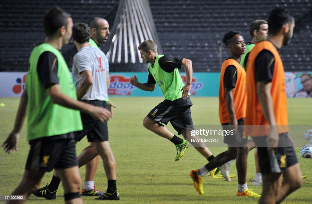 Liverpool football team captain Steven Gerrard (C) and his team attend a practice session at Bung Karno stadium in Jakarta on July 19, 2013 before their friendly match against Indonesian national team on July 20. Rodgers said that Liverpool's striker Luis Suarez was not for sale, after the club reportedly turned down a 30 million pound deal from Arsenal. AFP PHOTO / Bay ISMOYO