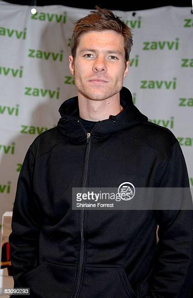 Liverpool Footballer Xabi Alonso signs EA Games' Fifa 09 at Zavvi on October 2 2008 in Liverpool England