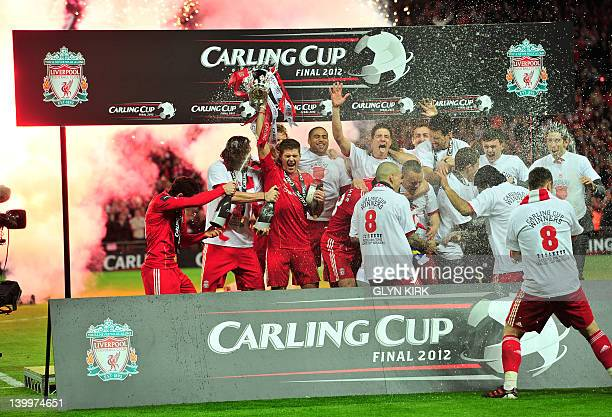 Liverpool footballers celebrate with the trophy and champagne after beating Cardiff City in a penalty shoot out in the League Cup Final at Wembley...